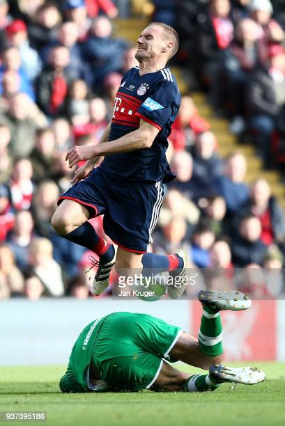 Alexander Zickler of Bayern Munich Legends clashes with David James of Liverpool Legends during the friendly match between Liverpool FC Legends and...