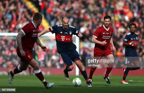 Alexander Zickler of Bayern Munich Legends controls the ball from John Arne Riise and Xabi Alonso of Liverpool Legends during the friendly match...