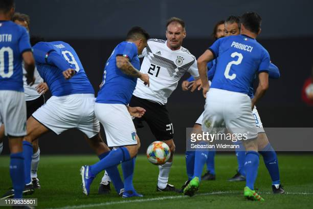 Alexander Zickler of DFBAllStars competes with Fabio Cannavaro of Azzurri Legends during the Friendly Match between the DFBAllStars and Azzurri...