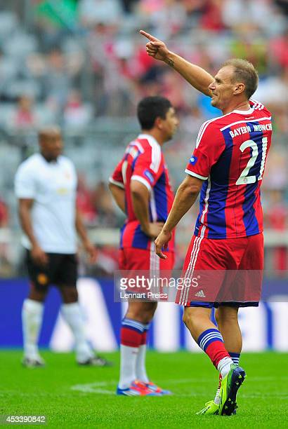 Alexander Zickler of FCB AllStars celebrates his team's third goal during the friendly match between FC Bayern Muenchen AllStars and Manchester...