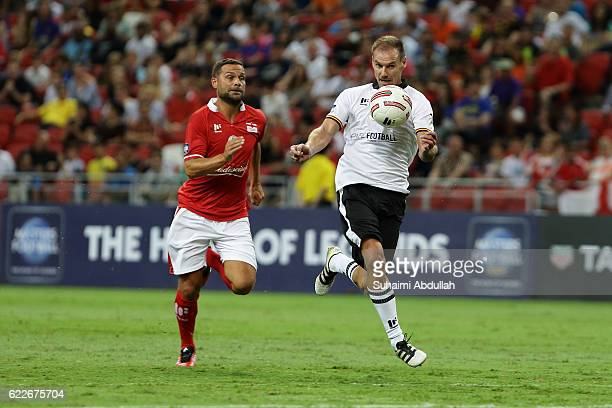 Alexander Zickler of Germany controls the ball as Luke Young of England gibes chase during the Battle of Europe match between England Masters and...