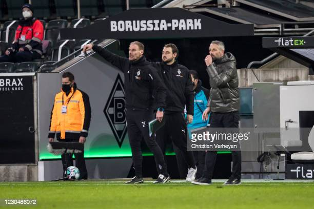 Alexander Zickler, Rene Maric and Head Coach Marco Rose of Borussia Moenchengladbach are seen during the Bundesliga match between Borussia...