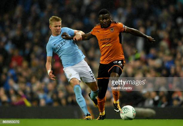 Alexander Zinchenko of Manchester City and Bright Enobakhare of Wolverhampton Wanderers battle for the ball during the Carabao Cup Fourth Round match...