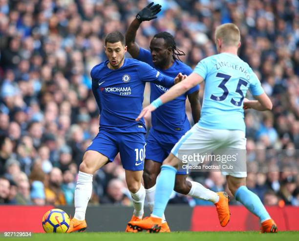 Alexander Zinchenko of Manchester City challenges Eden Hazard of Chelsea during the Premier League match between Manchester City and Chelsea at...