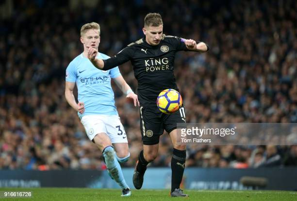 Alexander Zinchenko of Manchester City chases down Marc Albrighton of Leicester City during the Premier League match between Manchester City and...