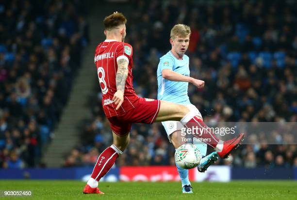 Alexander Zinchenko of Manchester City is faced by Josh Brownhill of Bristol City during the Carabao Cup SemiFinal First Leg match between Manchester...