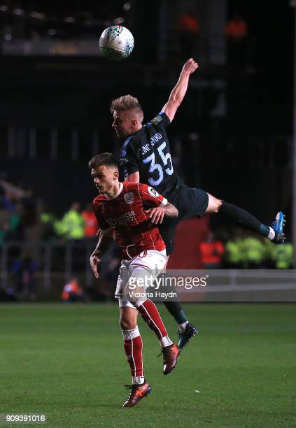 Alexander Zinchenko of Manchester City outjumps Jamie Paterson of Bristol City during the Carabao Cup semifinal second leg match between Bristol City...