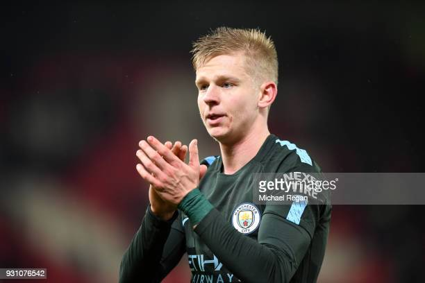 Alexander Zinchenko of Manchester City salutes the travelling fans after the Premier League match between Stoke City and Manchester City at Bet365...