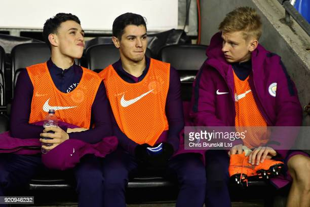 Alexander Zinchenko Phil Foden and Brahim Diaz all of Manchester City watch the action from the substitutes bench during the Emirates FA Cup Fifth...