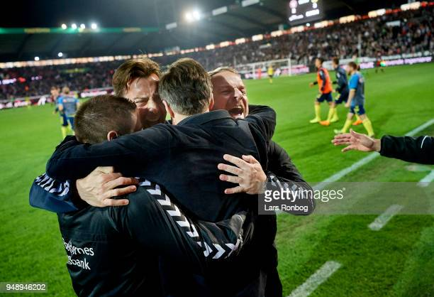 Alexander Zorniger head coach of Brondby IF celebrates with his staff and Troels Bech sports director of Brondby IF after the Danish Alka Superliga...