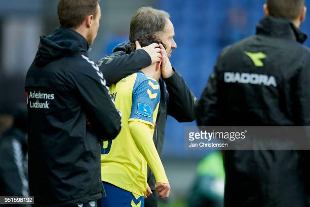 Alexander Zorniger head coach of Brondby IF gives Besar Halimi of Brondby IF a hug before Besar Halimi entering the pitch during the Danish DBU...
