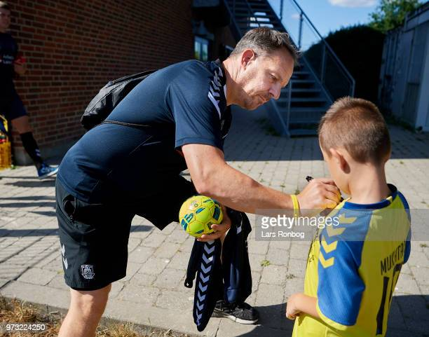 Alexander Zorniger head coach of Brondby IF signing an autograph for an young fan prior to the Brondby IF training session at Brondby Stadion on June...