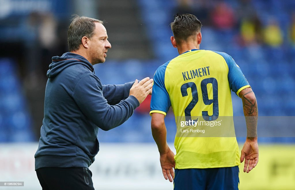 Alexander Zorniger, head coach of Brondby IF speaks to Jan Kliment of Brondby IF during the Danish Alka Superliga match between Brondby IF and FC Midtjylland at Brondby Stadion on July 16, 2017 in Brondby, Denmark.