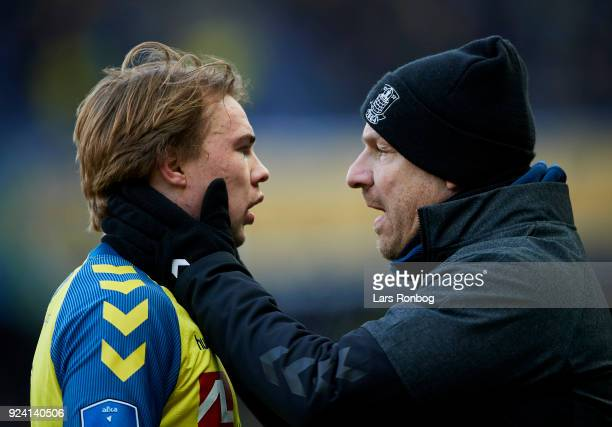 Alexander Zorniger head coach of Brondby IF speaks to Simon Tibbling of Brondby IF during the Danish Alka Superliga match between Brondby IF and FC...