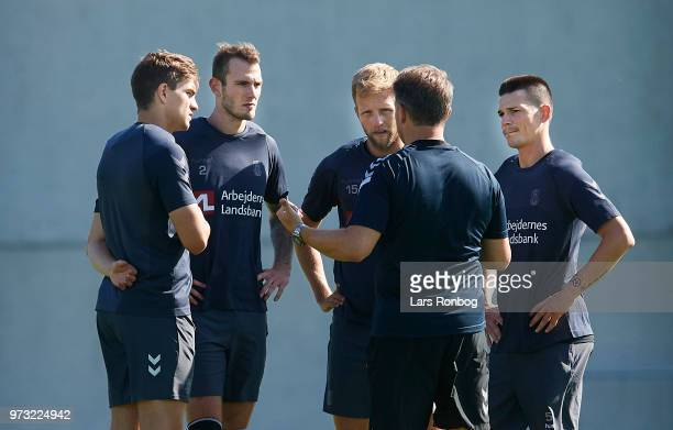 Alexander Zorniger head coach of Brondby IF speaks to the new players fr l Mikael Uhre Jens Martin Gammelby Bjorn Kopplin and Ante Erceg of Brondby...