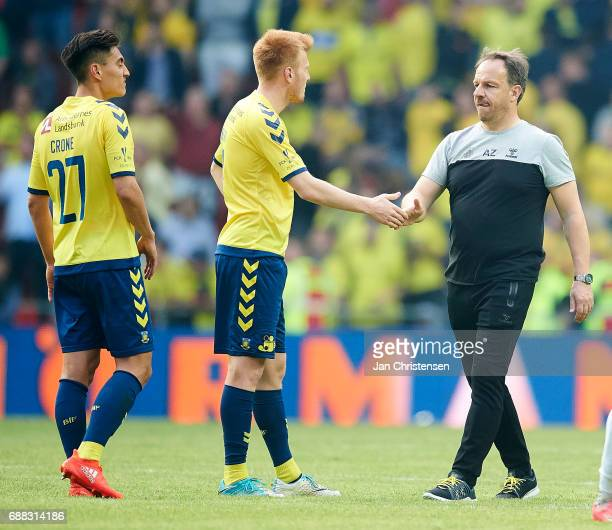 Alexander Zorniger head coach of Brondby IF Zsolt Kalmár of Brondby IF and Svenn Crone of Brondby IF looks dejected after the Danish Cup Final DBU...