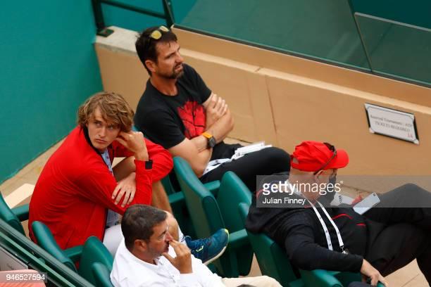 Alexander Zverev and Alexander Zverev Sr watch Mischa Zverev play during the Round of 64 match between Mischa Zverev and Felix AugerAliassime during...