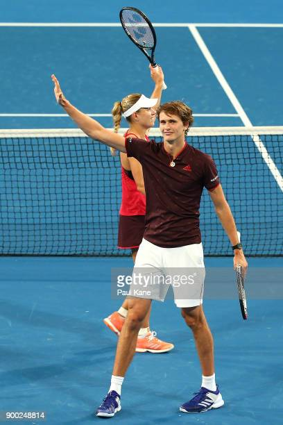 Alexander Zverev and Angelique Kerber of Germany celebrate winning the mixed doubles match against Elise Mertens and David Goffin of Belgium on day 3...