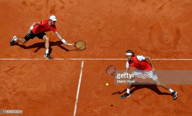 Alexander Zverev and Mischa Zverev of Germany in action against Julian Lenz and Daniel Masur of Germany during day three of the Hamburg Open 2019 at...