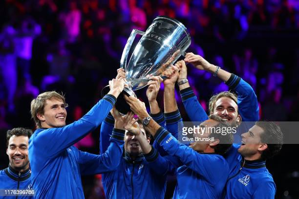 Alexander Zverev and Roger Federer of Team Europe lift the Laver Cup trophy after winning the Laver Cup in the final match of the tournament during...
