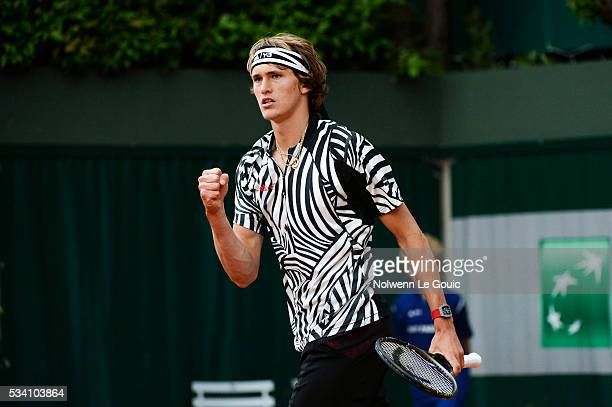 Alexander Zverev celebrates during the Men's Singles first round on day three of the French Open 2016 at Roland Garros on May 24 2016 in Paris France