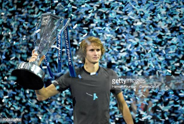 Alexander Zverev celebrates with the trophy after defeating Novak Djokovic in the singles Final during Day Eight of the Nitto ATP Finals at The O2...