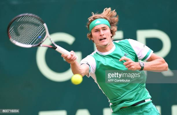 Alexander Zverev from Germany returns a ball to Roger Federer from Switzerland at the final of the Gerry Weber Open tennis tournament in Halle...