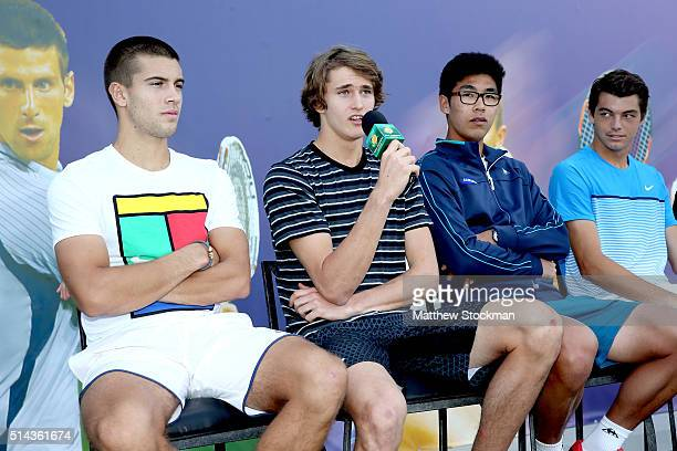 Alexander Zverev of Germany address the audiance while participating in the ATP #NextGen player panel with Borna Coric of Croatia Hyeon Chung of...