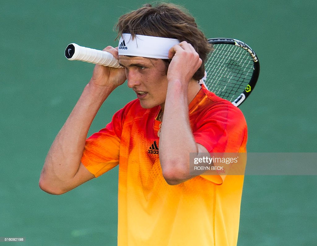 Alexander Zverev of Germany adjusts his headband during his match against Rafael Nadal of Spain at the BNP Paribas Open at the Indian Wells Tennis Garden in Indian Wells, California, on March 16, 2016. Nadal defeated the 18-year-old German 6-7(8), 6-0, 7-5. / AFP / ROBYN