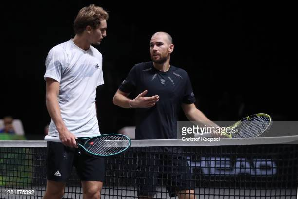 Alexander Zverev of Germany and Adrian Mannarino of France talk after the match of day five of the Bett1Hulks Championship Tennis Tournament at...