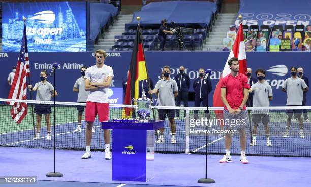Alexander Zverev of Germany and Dominic Thiem of Austria attend the trophy ceremony after Thiem won in a tiebreak during their Men's Singles final...