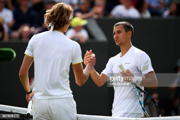 Alexander Zverev of Germany and Evgeny Donskoy of Russia shake hands after their Gentlemen's Singles first round match on day two of the Wimbledon...