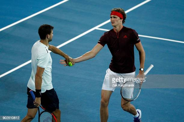 Alexander Zverev of Germany and Grigor Dimitrov of Bulgaria react during a Fast Fours Exhibtion doubles match against Nick Kyrgios and Lleyton Hewitt...