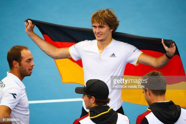 Alexander Zverev of Germany and his team celebrate his victory over Nick Kyrgios of Australia following their forth round rubber of the Davis Cup...