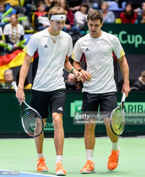Alexander Zverev of Germany and Mischa Zverev of Germany are seen during day two of the Davis Cup World Group first round between Germany and Belgium...