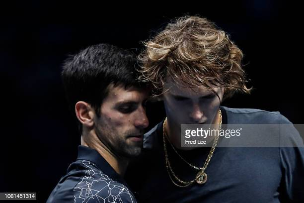 Alexander Zverev of Germany and Novak Djokovic of Serbia embrace after their singles round robin match during Day Four of the Nitto ATP Finals at The...