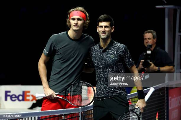 Alexander Zverev of Germany and Novak Djokovic of Serbia pose for a photo before their singles final during Day Eight of the Nitto ATP Finals at The...