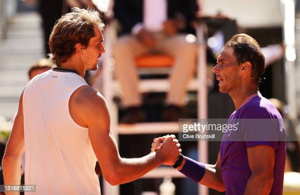 Alexander Zverev of Germany and Rafael Nadal of Spain interact following their Quarter Final match during Day Nine of the Mutua Madrid Open at La...