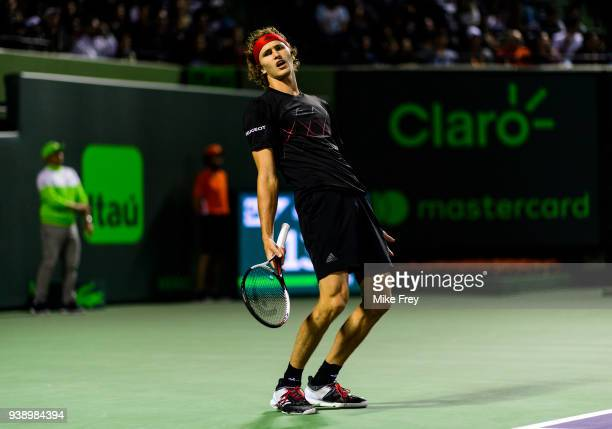 Alexander Zverev of Germany bends over backwards after hitting a shot out during his match with Nick Kyrgios of Australia during Day 9 of the Miami...
