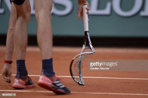 Alexander Zverev of Germany breaks his racket during his mens singles second round match against Dusan Lajovic of Serbia during day 4 of the 2018...
