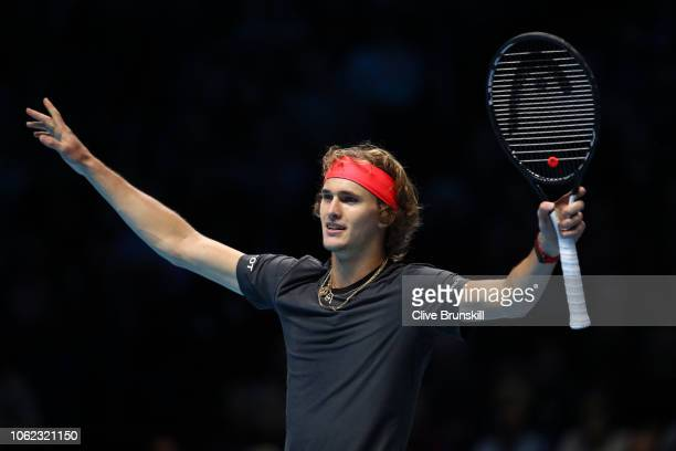 Alexander Zverev of Germany celebrates after winning match point in his third singles round robin match against John Isner of The United States...