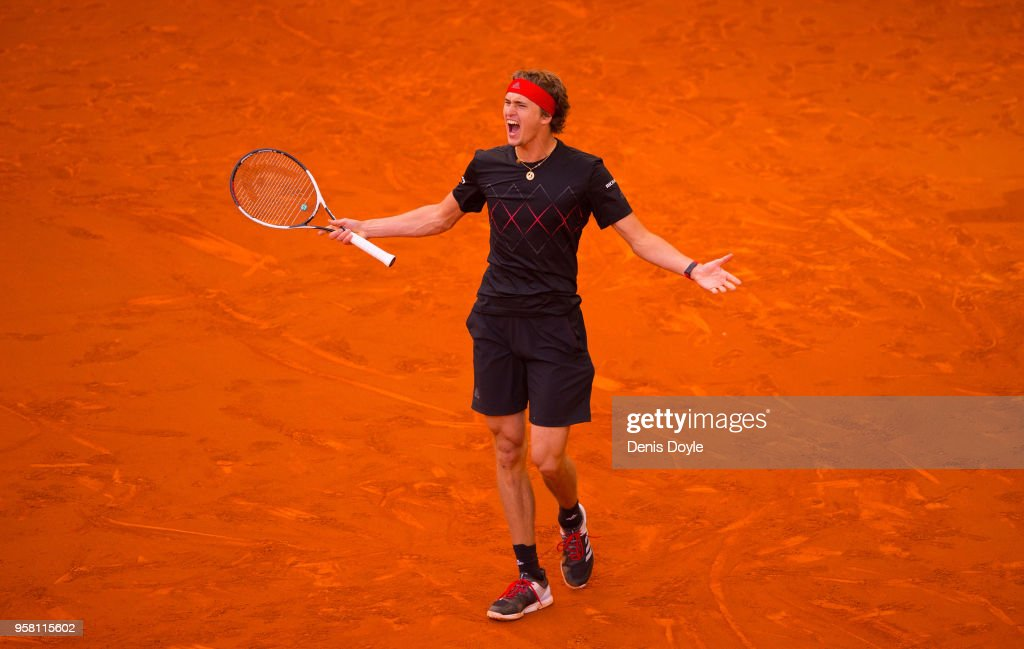 Alexander Zverev of Germany celebrates after winning the final against Dominic Thiem of Austriaduring day nine of the Mutua Madrid Open tennis tournament at the Caja Magica on May 13, 2018 in Madrid, Spain.