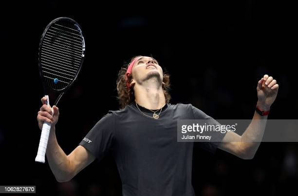 Alexander Zverev of Germany celebrates defeating Roger Federer of Switzerland in his match during Day Seven of the Nitto ATP Finals at The O2 Arena...