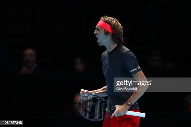 Alexander Zverev of Germany celebrates in his semi finals singles match against Roger Federer of Switzerland during Day Seven of the Nitto ATP Finals...