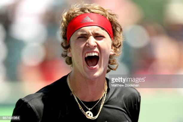 Alexander Zverev of Germany celebrates match point against Daniil Medvedev of Russia during the Miami Open Presented by Itau at Crandon Park Tennis...