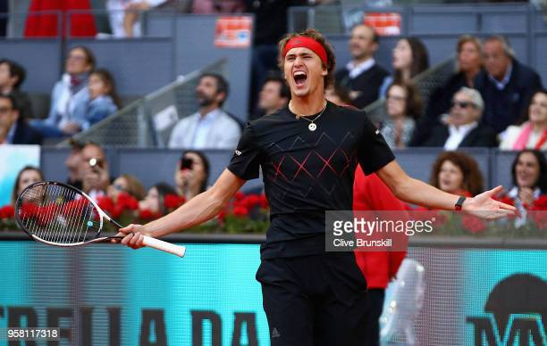 Alexander Zverev of Germany celebrates match point against Dominic Thiem of Austria in the mens final during day nine of the Mutua Madrid Open tennis...