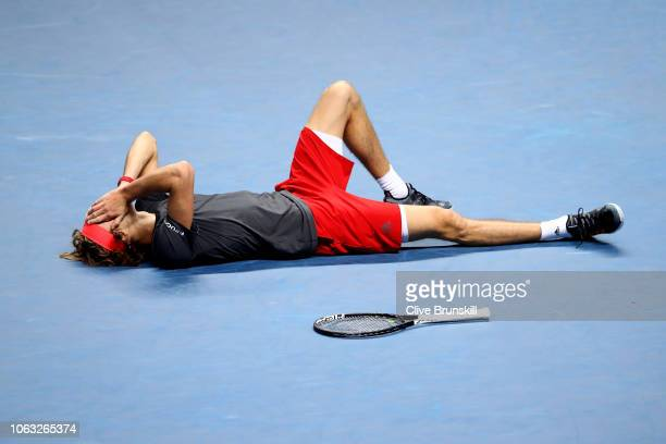 Alexander Zverev of Germany celebrates match point following the singles final against Novak Djokovic of Serbia during Day Eight of the Nitto ATP...