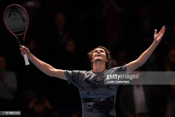 Alexander Zverev of Germany celebrates victory after his singles match against Daniil Medvedev of Russia during Day Six of the Nitto ATP Finals at...
