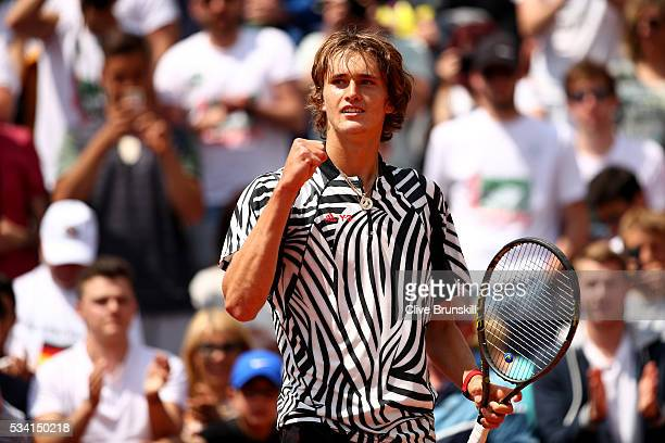 Alexander Zverev of Germany celebrates victory during the Men's Singles first round match against PierreHughers Herbert of France on day four of the...