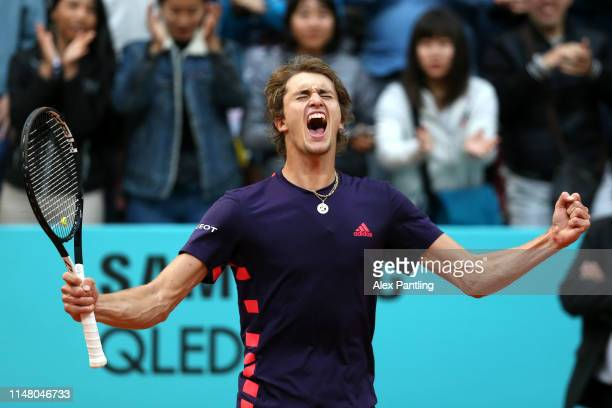 Alexander Zverev of Germany celebrates victory in his match against Hubert Hurkacz of Poland during day six of the Mutua Madrid Open at La Caja...